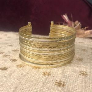 Gold and silver cuff bracelet from Anthropologie.